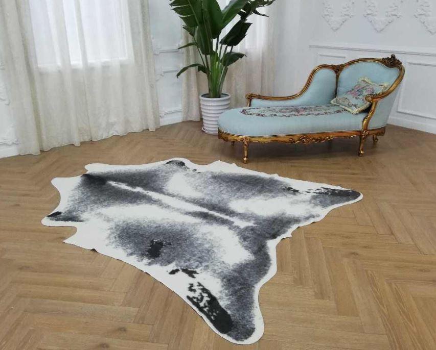 sacar manchas alfombra piel
