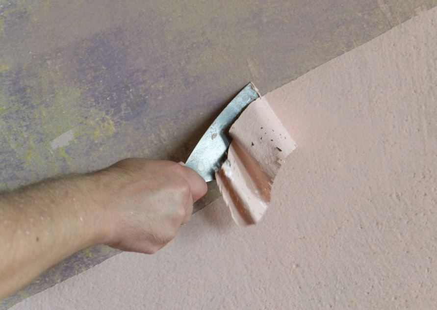 como quitar pintura plastica de pared de cemento